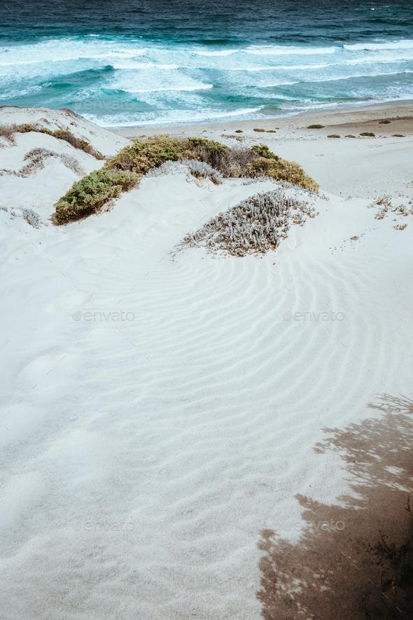 Stunning desolate landscape of sand dunes, ocean waves on Baia Das Gatas. North of Calhau, Sao - Stock Photo - Images
