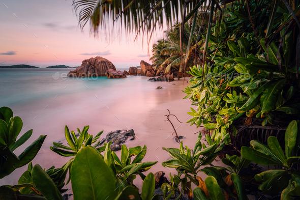 Paradise exotic beach on La Digue Island, Seychelles. Long Exposure during amazing sunset - Stock Photo - Images