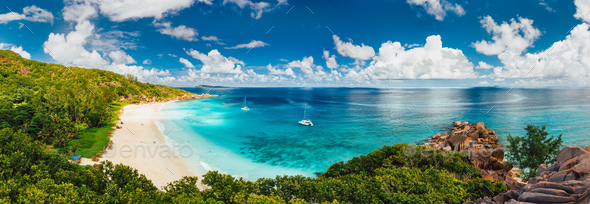 Aerial Pano of Grand Anse beach at La Digue island in Seychelles. White sandy beach with blue ocean - Stock Photo - Images