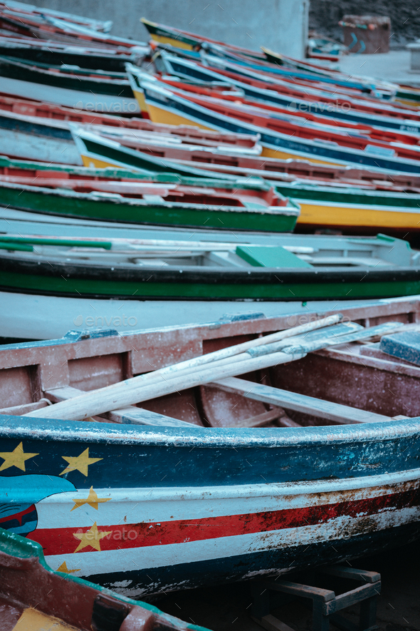 Multicolored local fishing boats waiting on the coast of good weather. Ponta do Sol Santo Antao Cape - Stock Photo - Images