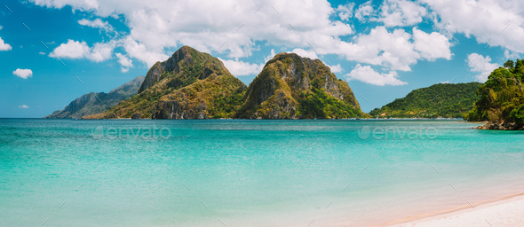 El Nido, Corong Corong beach with massive limestone mountain ridge top with blue lagoon in front - Stock Photo - Images