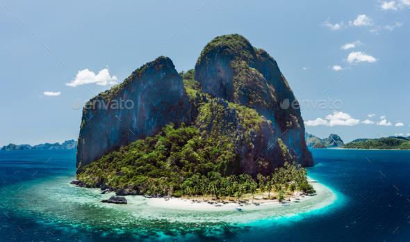 Aerial drone view of tropical Pinagbuyutan Island and ipil beach in blue ocean El Nido, Palawan - Stock Photo - Images