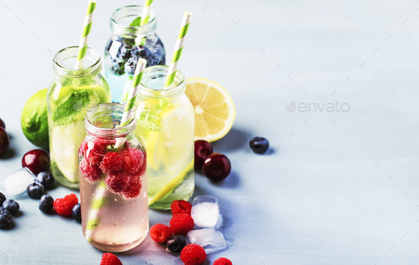Berry, fruit and citrus non-alcoholic refreshing ice cold beverages - Stock Photo - Images