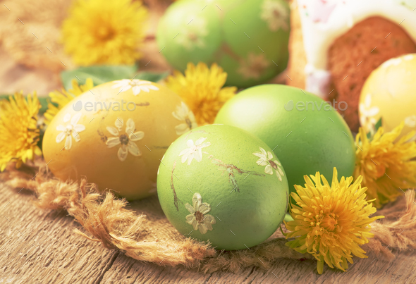 Easter green and yellow painted eggs - Stock Photo - Images