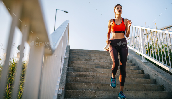 Happy young woman exercising outdoors. Living healthy life - Stock Photo - Images