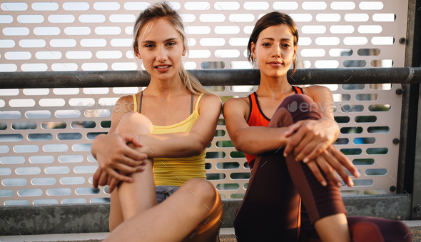 Beautiful happy women friends working out, exercising, running, jogging outdoor - Stock Photo - Images