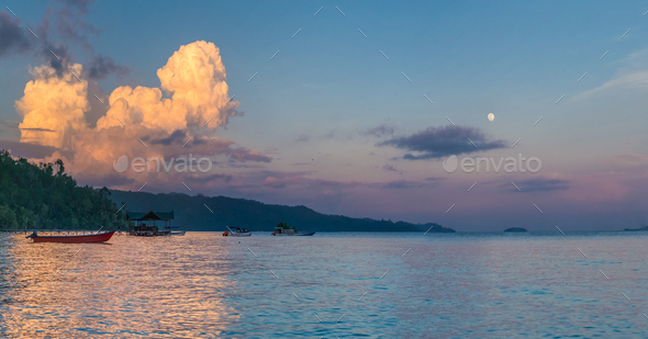 Huge White Clouds above Diving Station on Sunset, Moon in Sky, Homestay Gam Island, West Papuan - Stock Photo - Images