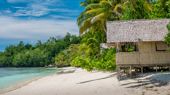 Bamboo Hut under Palm Trees of an Homestay on Gam Island, West Papuan, Raja Ampat, Indonesia - Stock Photo - Images