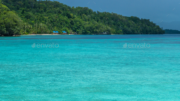 Beautiful Blue Lagoone shortly before Thunderstorm, Gam Island, West Papuan, Raja Ampat, Indonesia - Stock Photo - Images