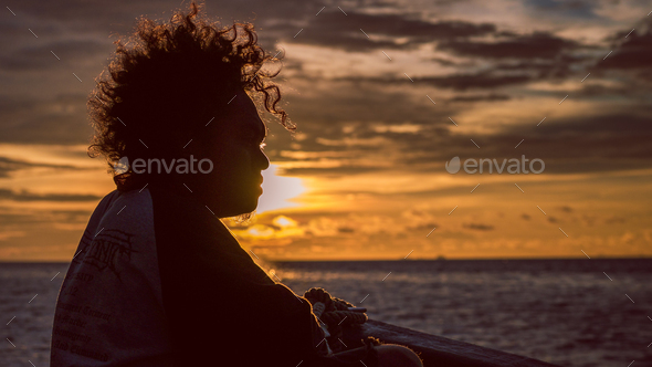 Papuans in Sunset light on the Way to Kri Island. Raja Ampat, Indonesia, West Papua - Stock Photo - Images