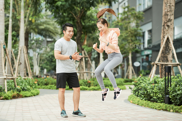 Pretty woman exercising with trainer - Stock Photo - Images