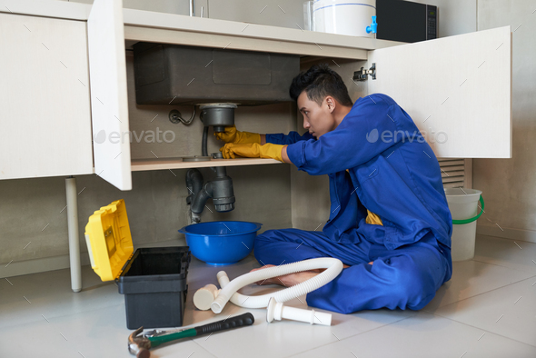 Checking drain - Stock Photo - Images