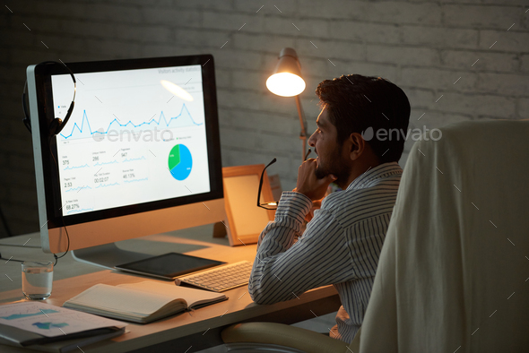 Analyzing business chart - Stock Photo - Images