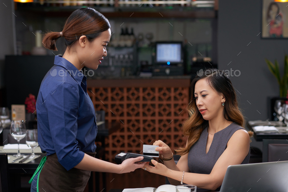 Paying for cafe - Stock Photo - Images