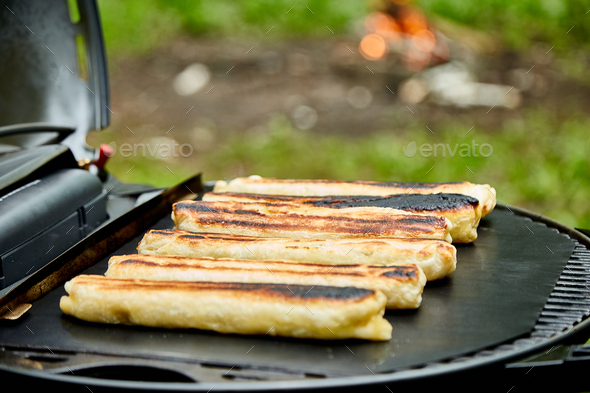 Grilled cheese puff pastry on the grill gas outdoor. - Stock Photo - Images