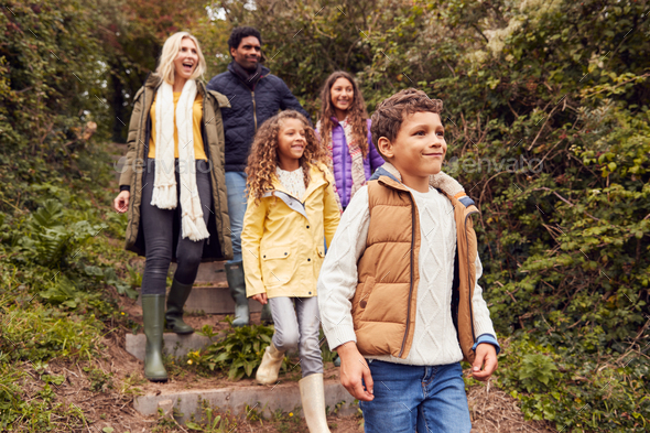 Multi-Cultural Family Walking Down Steps In Countryside On Winter Beach Vacation - Stock Photo - Images