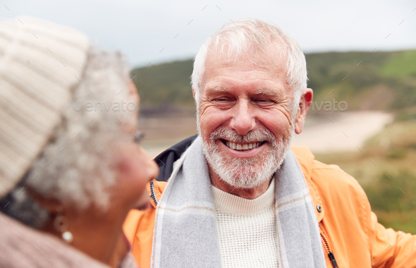 Close Up Of Loving Active Senior Couple Taking A Break As They Walk Along Coastal Path In Winter - Stock Photo - Images