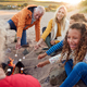 Multi-Generation Family Toasting Marshmallows Around Fire On Winter Beach Vacation - PhotoDune Item for Sale