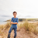 Portrait Of Boy Exploring Sand Dunes On Winter Beach Vacation - PhotoDune Item for Sale