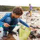 Children With Pet Dog Looking In Rockpools On Winter Beach Vacation - PhotoDune Item for Sale