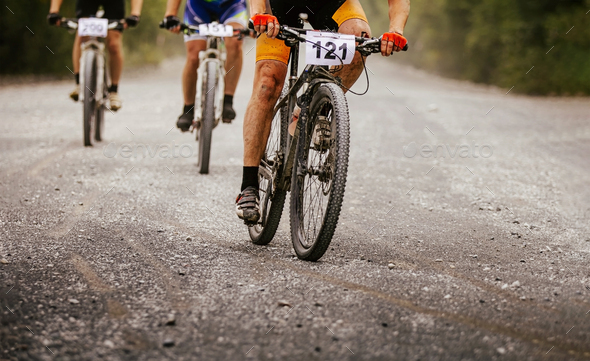 three cyclists riders on mountain bikes - Stock Photo - Images