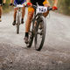 three cyclists riders on mountain bikes - PhotoDune Item for Sale