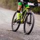 cyclist rider on mountain bike downhill on gravel road - PhotoDune Item for Sale
