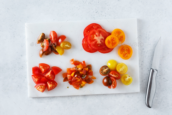 Different tomatoes cut in different ways. Ingredients - Stock Photo - Images