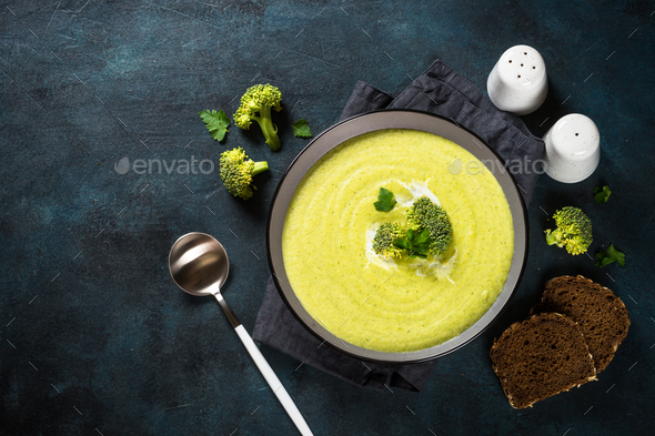 Broccoli cream soup in the bowl on dark table - Stock Photo - Images