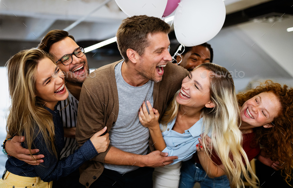 Happy business people celebrating success at company - Stock Photo - Images