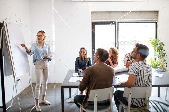 Creative professional designers brainstorming in office. Business, design, work, idea concept - Stock Photo - Images