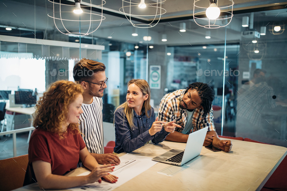 Successful group of designers, business people at work in office - Stock Photo - Images