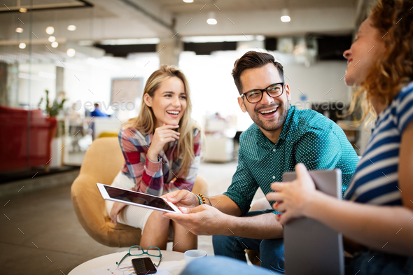 Business people brainstorming and chatting at workplace office - Stock Photo - Images
