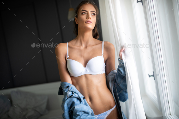 Beautiful alluring young woman in sexy white lingerie with glamorous face - Stock Photo - Images