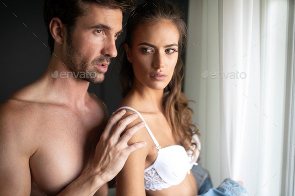 Young sensual passionate couple making love in bed - Stock Photo - Images