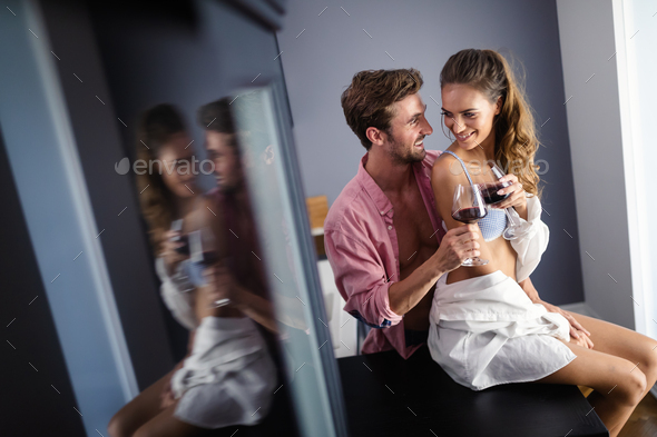 Passionate beautiful couple in bedroom enjoying foreplay - Stock Photo - Images