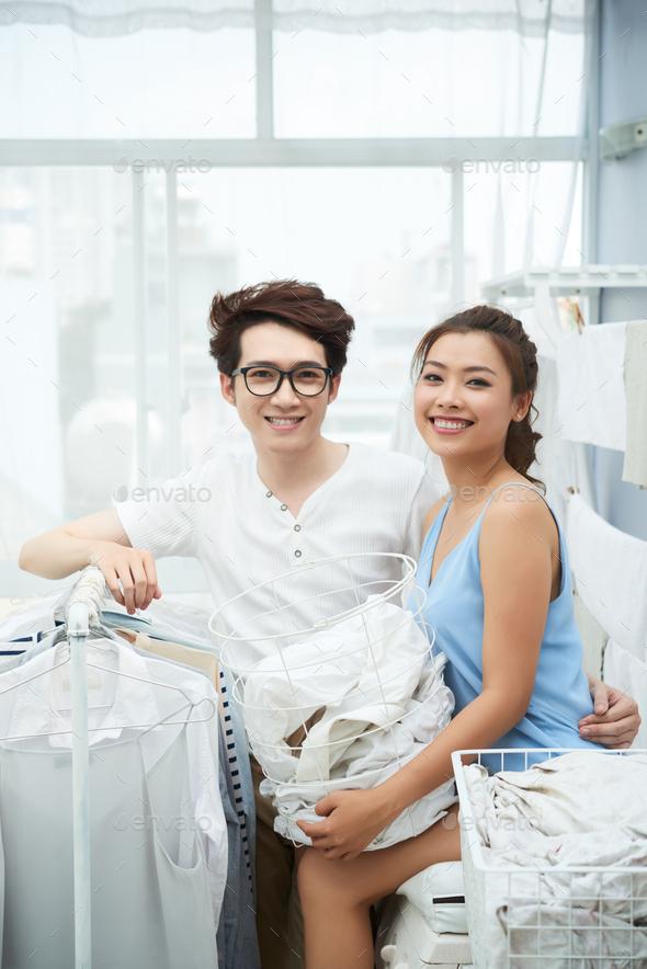 Cheerful couple doing laundri - Stock Photo - Images