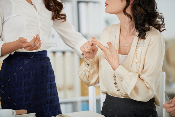 Female coworkers discussing ideas - Stock Photo - Images