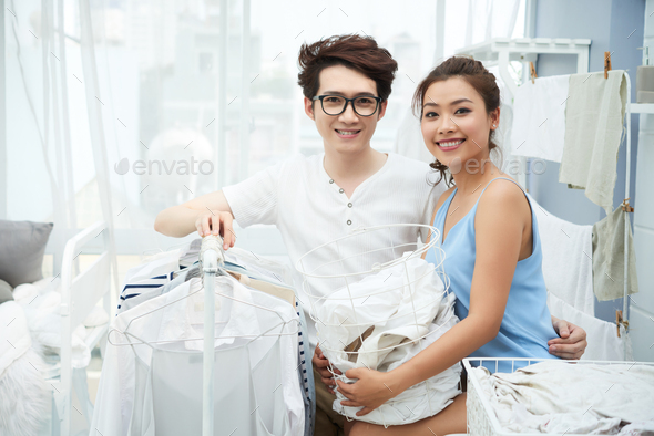 Couple washing clothes - Stock Photo - Images