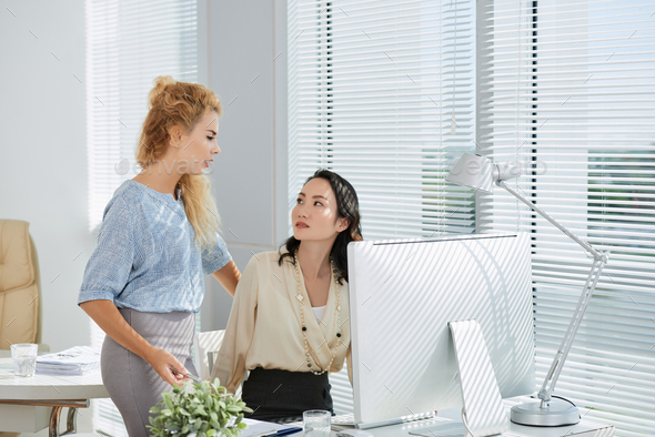 Talking female colleagues - Stock Photo - Images