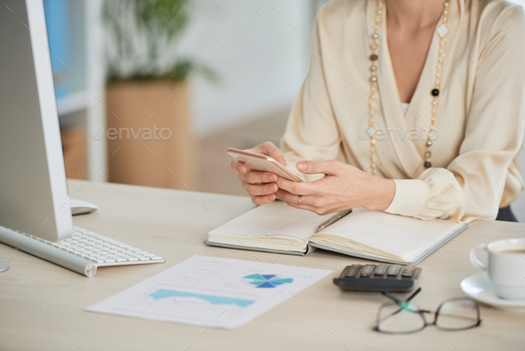 Business lady using app - Stock Photo - Images