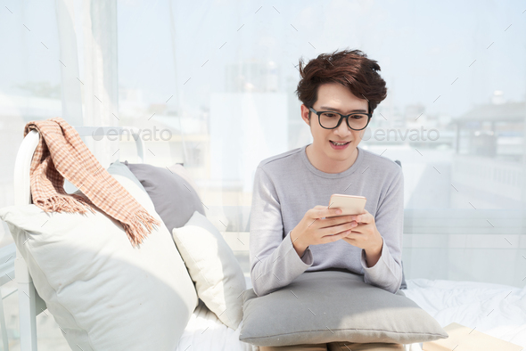 Texting young man - Stock Photo - Images