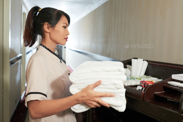 Hotel maid working - Stock Photo - Images