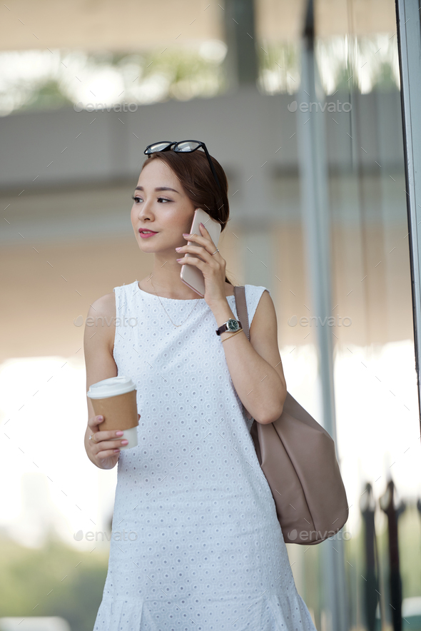 Pretty woman with smartphone and coffee - Stock Photo - Images