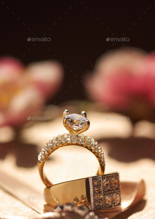 Close-up view of the diamond golden engagement rings - Stock Photo - Images