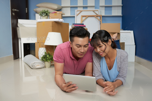 Couple Resting In New Apartment - Stock Photo - Images