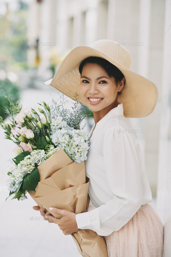Beautiful lady with flowers - Stock Photo - Images