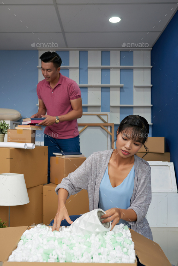 Couple Moving In New Apartment - Stock Photo - Images