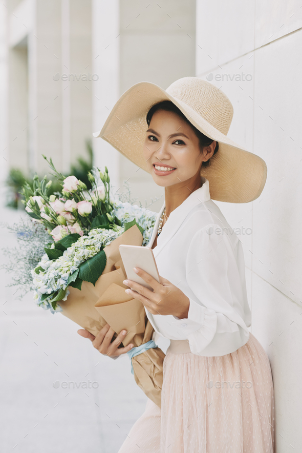 Pretty woman with bouquet - Stock Photo - Images