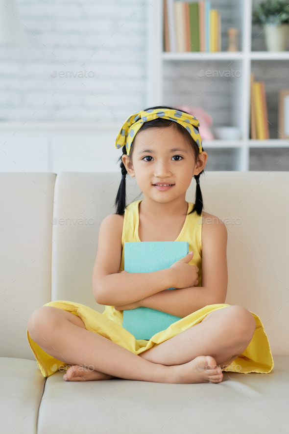 Girl resting on sofa - Stock Photo - Images